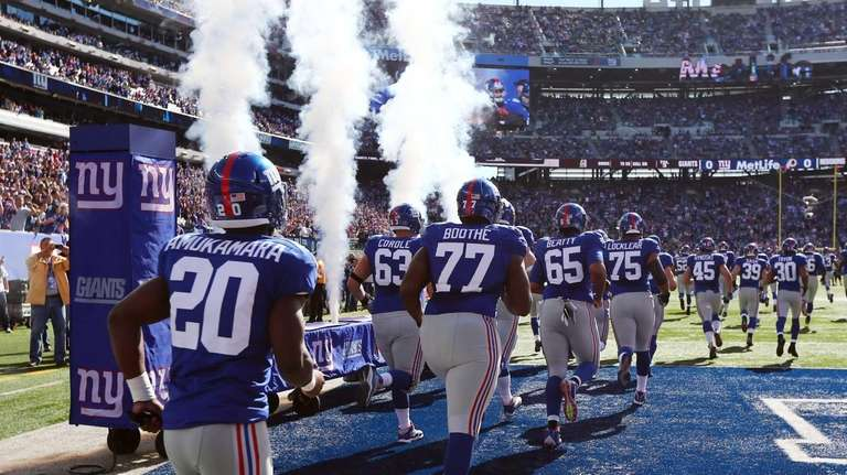The Giants take the field to play against
