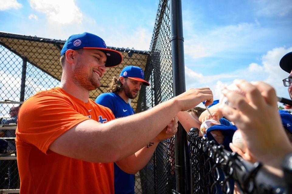 New York Mets players J.D. Davis, (left) and
