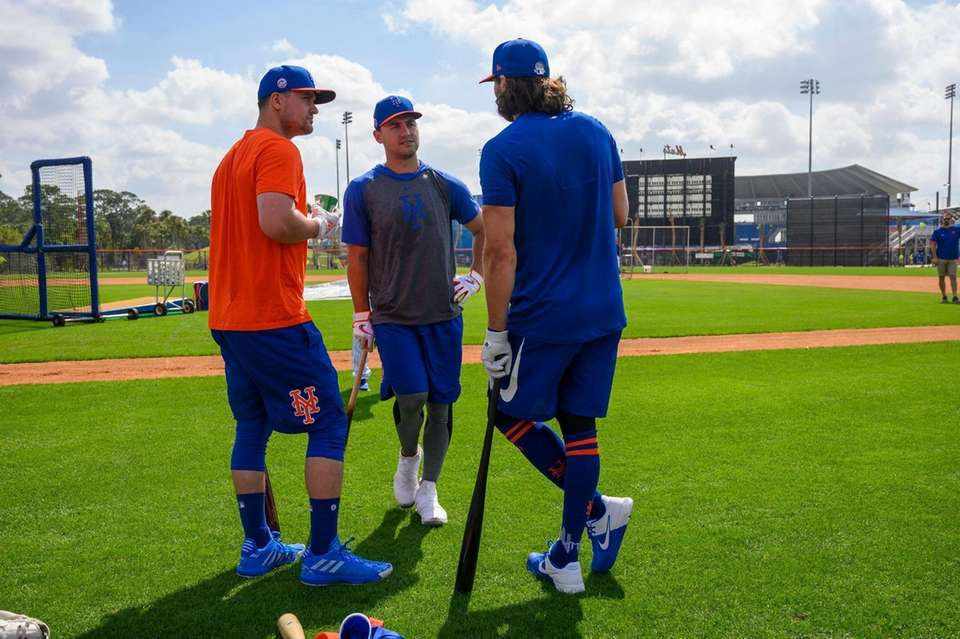 New York Mets players (L/R) J.D. Davis, Michael