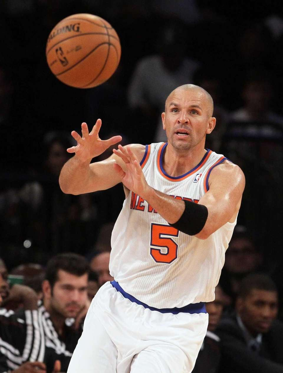 Jason Kidd passes the ball during a game