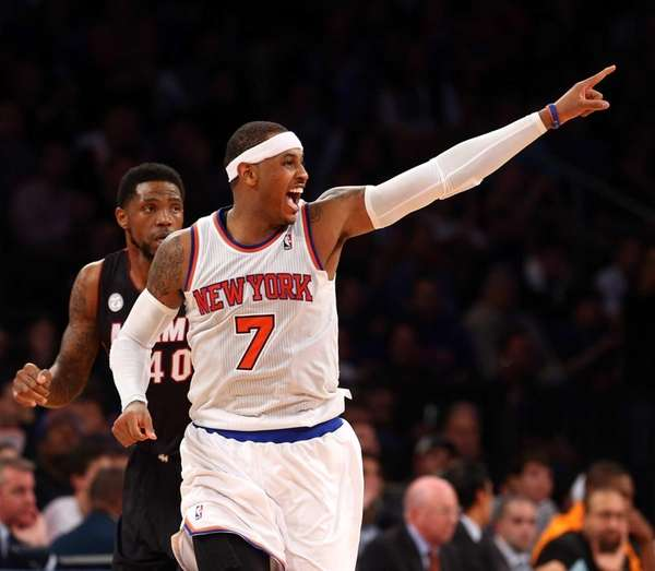 Carmelo Anthony celebrates after sinking a basket in