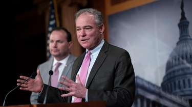 Sen. Tim Kaine (D-Va.), joined at left by