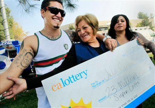 Lottery winner Julie Cervera, center, looks at her