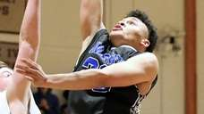 Smithtown Christian guard Gabe Gibson drives the paint