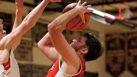 Southold guard Nick Grathwohl gets fouled on the