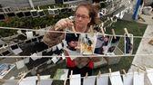 Freelance documentary photographer Tenney McClane, of Astoria, hangs