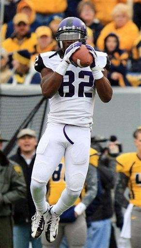 TCU's Josh Boyce completes a catch during a