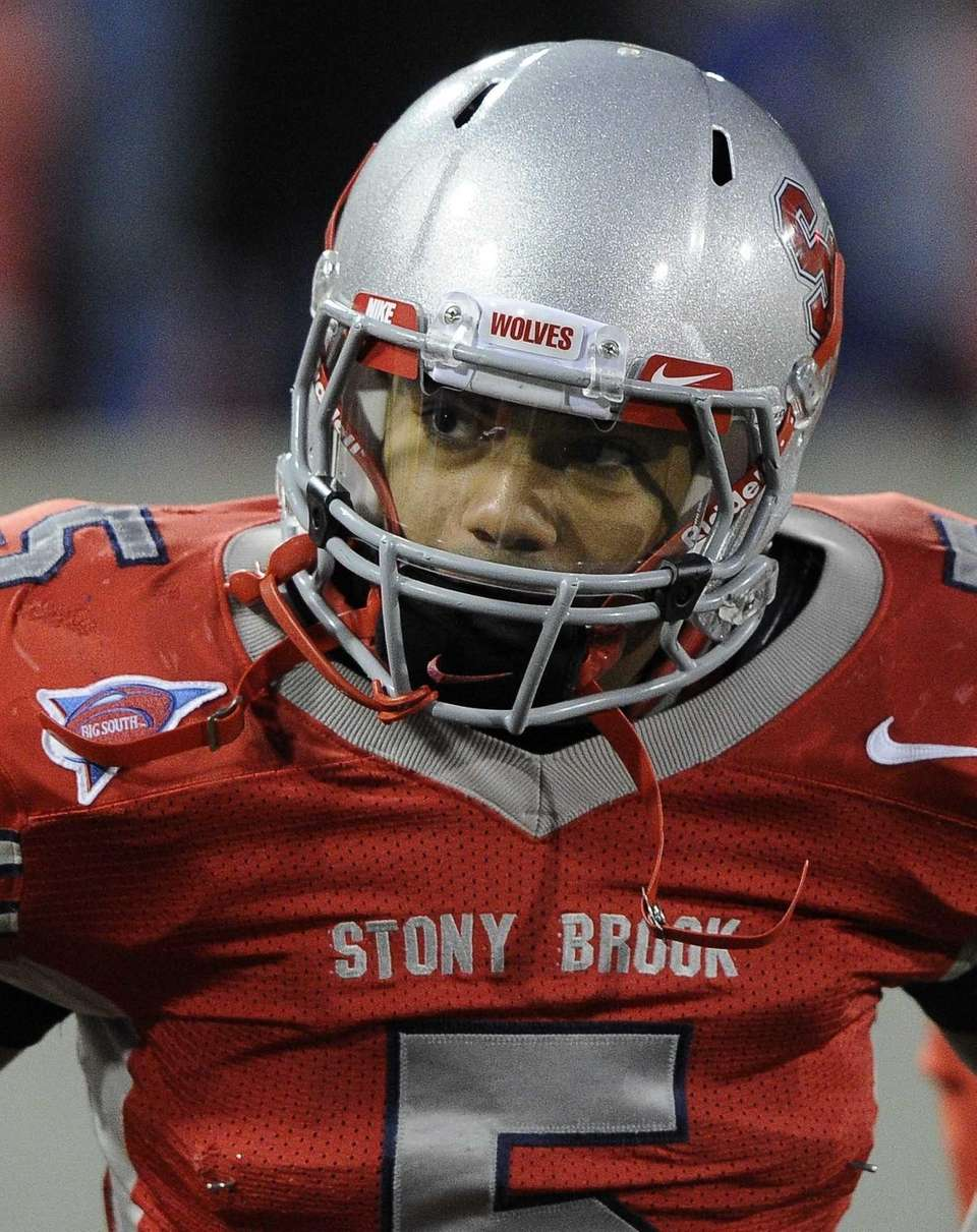 Stony Brook's Miguel Maysonet stands on the sideline