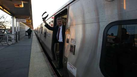 A LIRR worker signals that all is clear