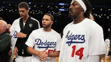 From left, Brook Lopez, Deron Williams and Gerald