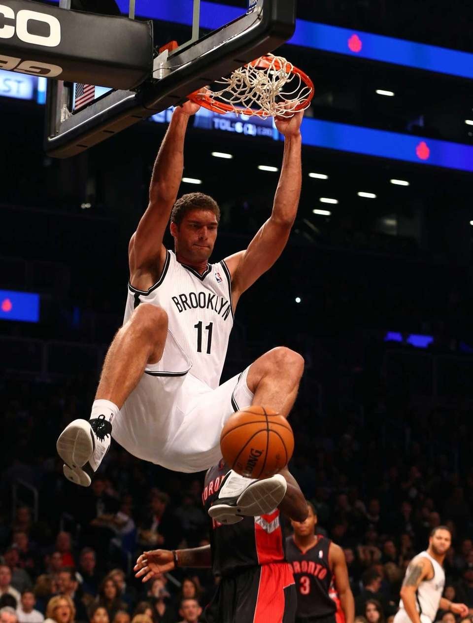 Brook Lopez dunks the ball during a game