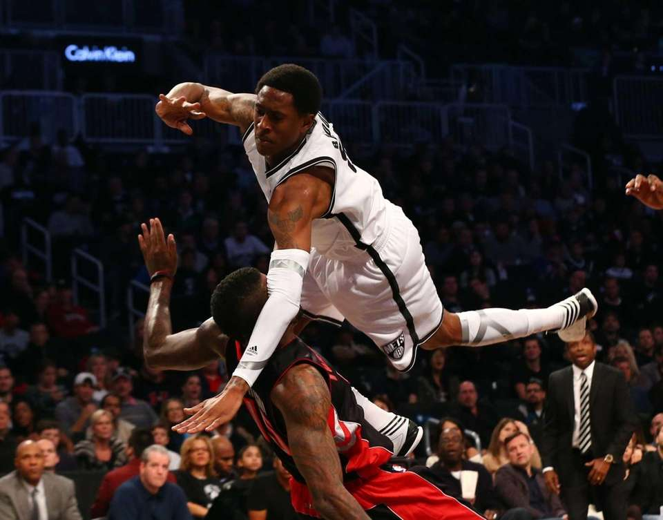 MarShon Brooks goes airborne after colliding into Amir