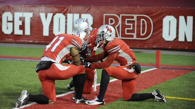 Stony Brook's Cedrick Moore, Kevin Norrell, and Davonte