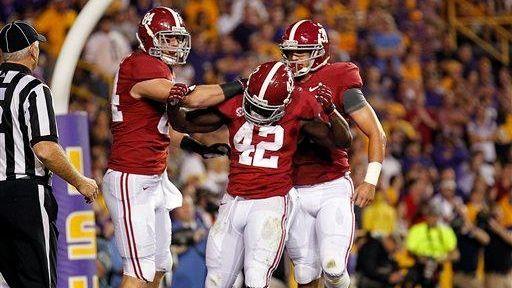 Alabama running back Eddie Lacy (42) celebrates his