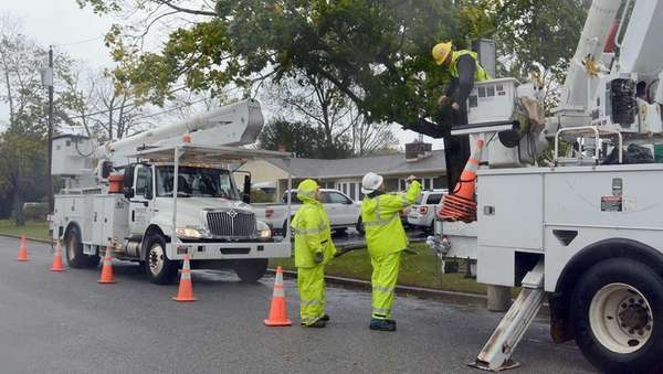 LIPA Electrical contractors work to restore power in