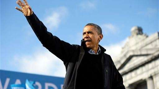 President Barack Obama waves to supporters during a