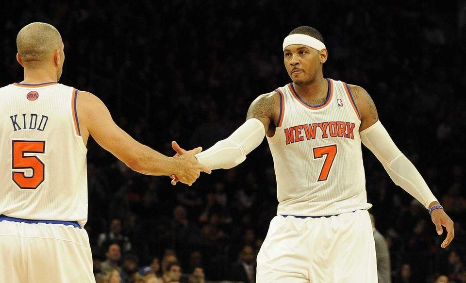 Jason Kidd and Carmelo Anthony shake hands on
