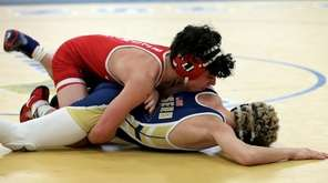East Islip's Justin Shayew (red) wrestles Northport's Matt