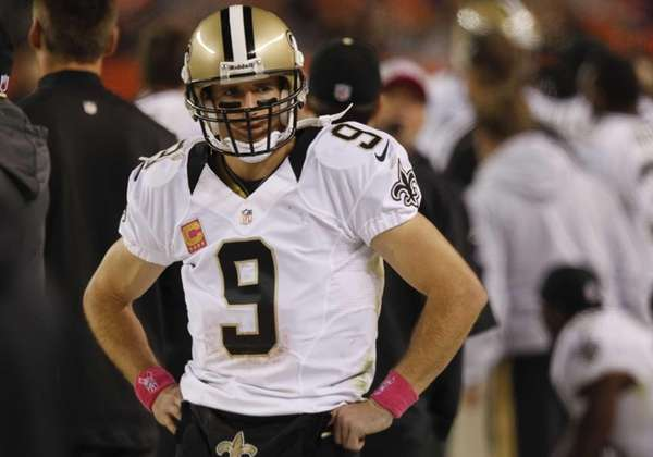 New Orleans Saints quarterback Drew Brees stands on