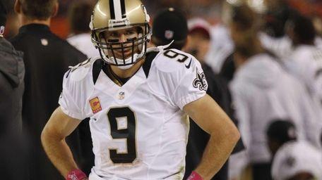 New Orleans Saints quarterback Drew Brees stands on
