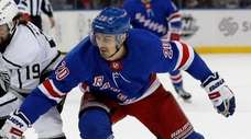 Chris Kreider of the Rangers battles for the