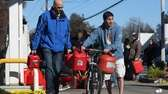 Two Plainview men walk their gas supplies Sunday
