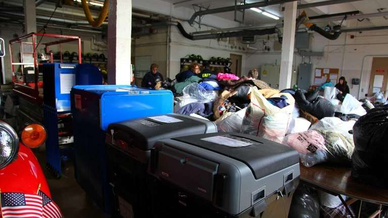 Voting machines sit amongst donated clothing at the
