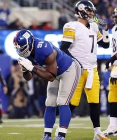 Giants defensive end Justin Tuck celebrates after sacking