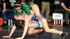 Lynbrook's Allie Fitzgerald rides the back of Manhasset's