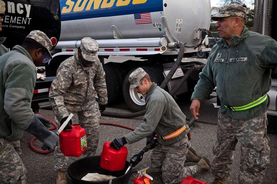 A member of the National Guard fills up