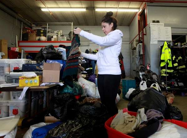 Volunteer Santina Peralta organizes clothing donations at the