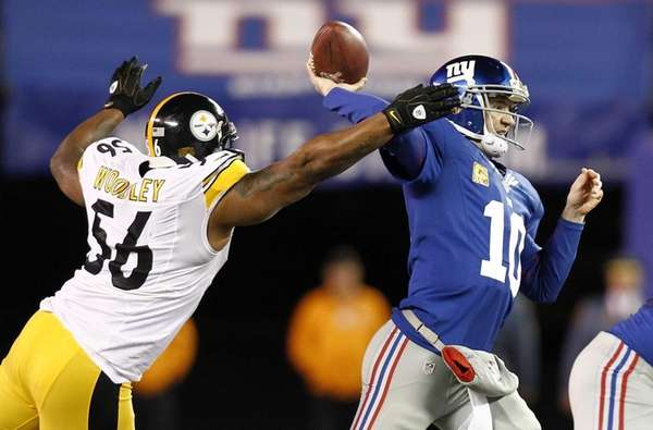 LaMarr Woodley of the Pittsburgh Steelers closes in