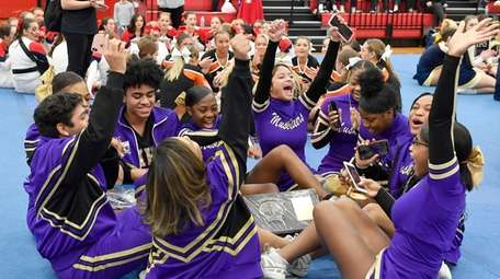 Central Islip cheerleaders celebrate their first place win