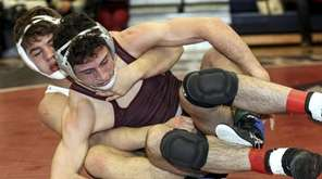 Christian Hansen of Cold Spring Harbor wrestles Michael