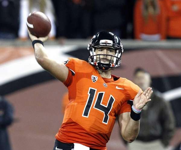 Oregon State quarterback Cody Vaz throws a pass