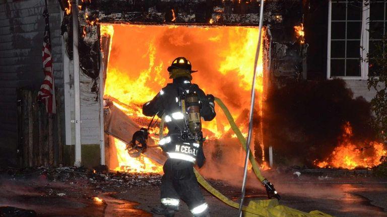 The North Massapequa Fire Department fights a house