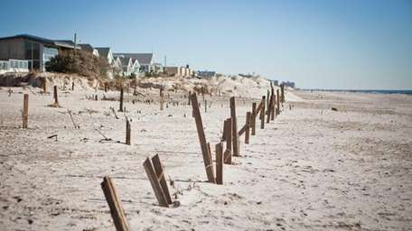 Large portions of the protective dune between homes