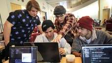 At the tech competition, studentsbrainstorm ideas for solutions