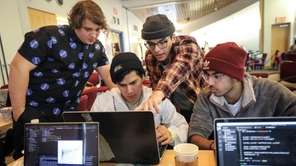 At the tech competition, students brainstorm ideas for solutions