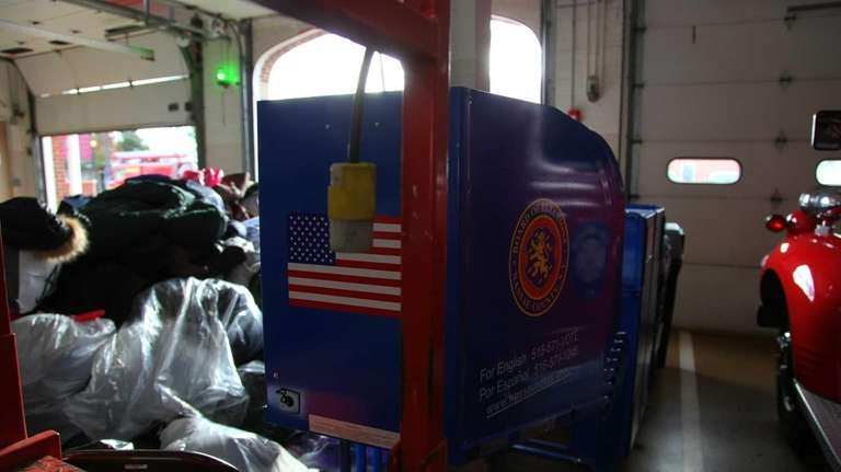 A voting machine sits amongst donated clothing at
