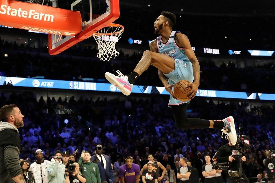 Miami Heat's Derrick Jones Jr. competes in the