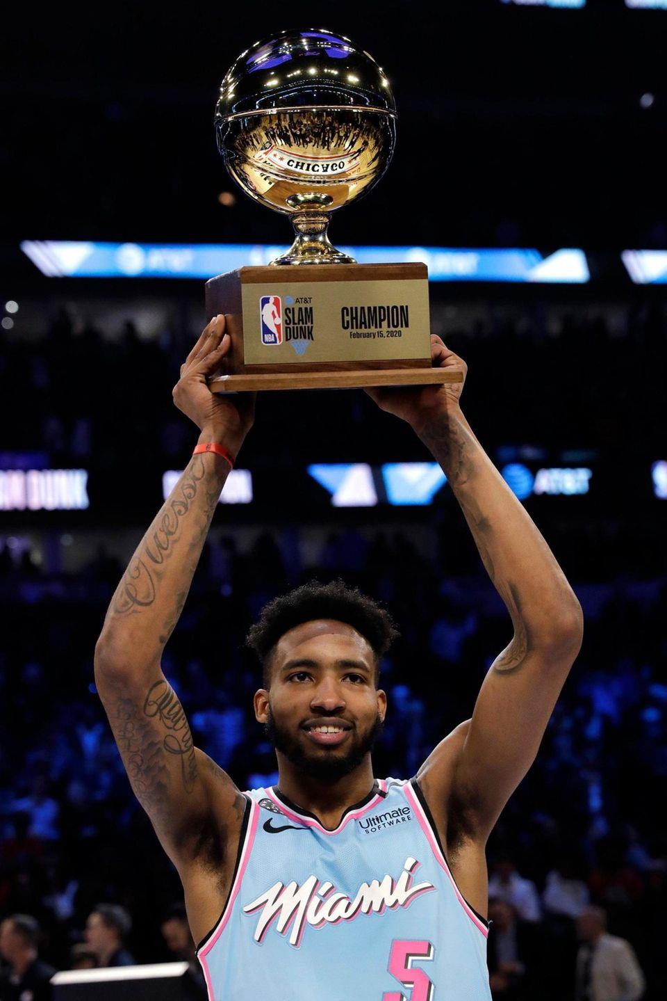 Miami Heat's Derrick Jones Jr. holds the trophy