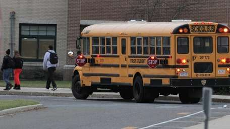 A school bus arrives with students this morning