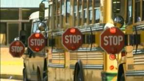 School buses line up in this file photo.