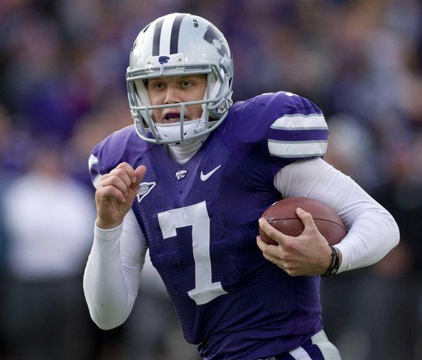 Kansas State quarterback Collin Klein runs for a