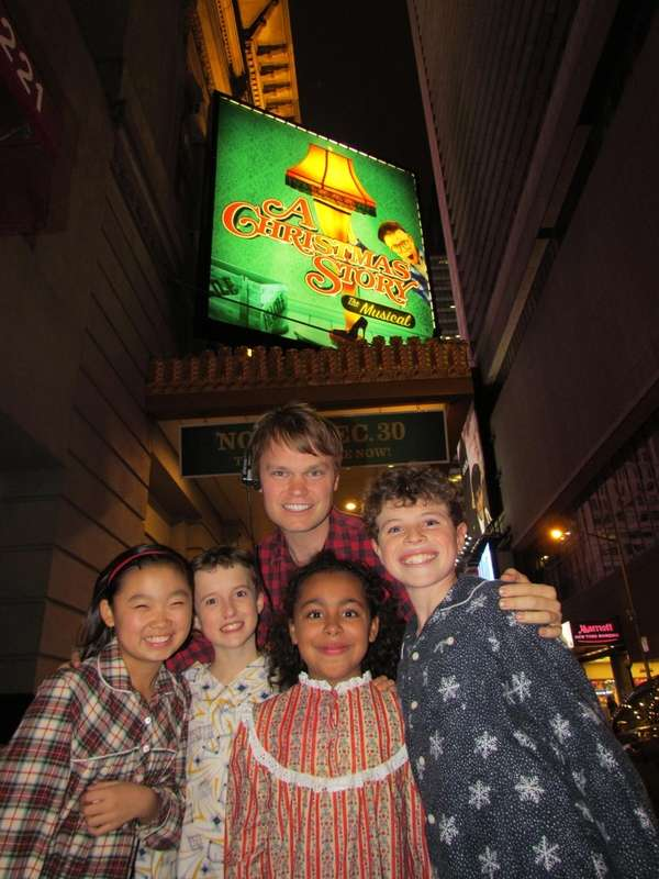 John Mara Jr., background, outside the Broadway theater