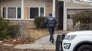 Nassau police investigate on Feb. 3 the scene