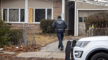 Nassau police investigate on Feb. 3 the scene