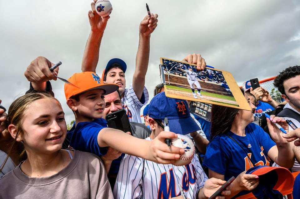 New York Mets fans wait for autographs during