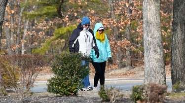 A couple goes for an early morning walk